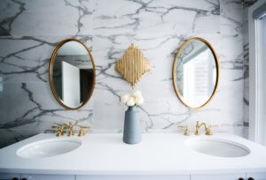 A sleak and modern double vanity with a full wall marble backsplash.